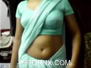 Indian lady removing blue saree